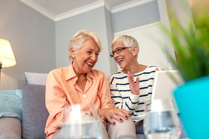 two senior women enjoying time together in their retirement home