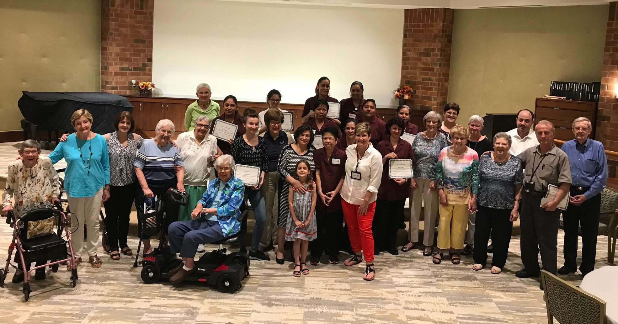 Team members, residents and guests gather at Beacon Hill's ESL graduation ceremony