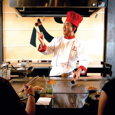 Chef Entertaining While Cooking