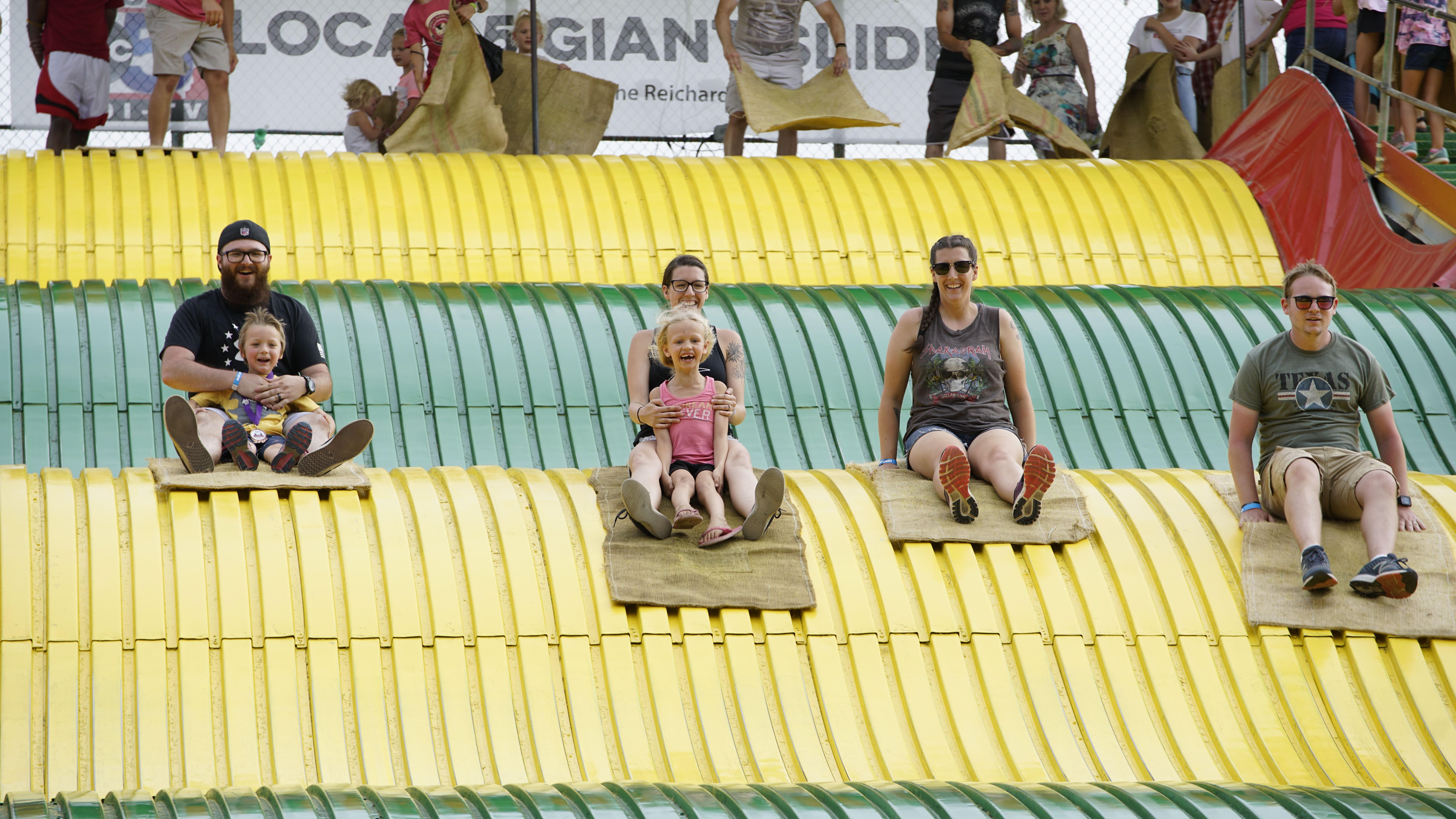 Fairgoers on the Giant Slide