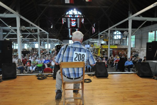 An accordion contest participant plays his song in Farm Bureau Pioneer Hall.