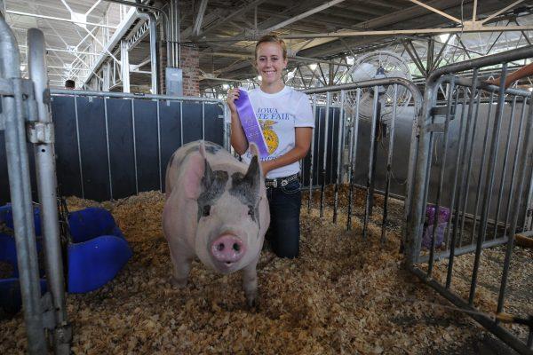 Erin Schmidt of Watkins and her FFA Purple award-winning hog.