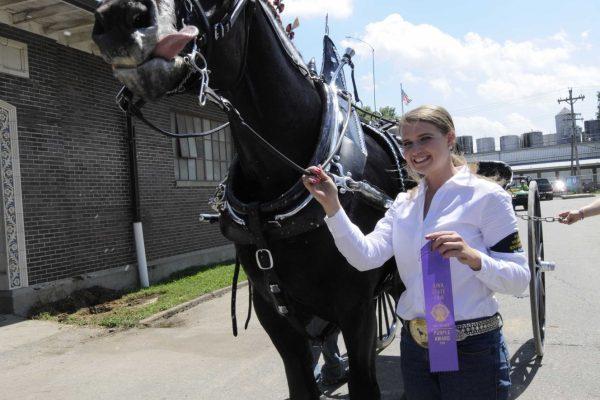 Kari Joe Konrad of Runnels poses with her award-winning horse.