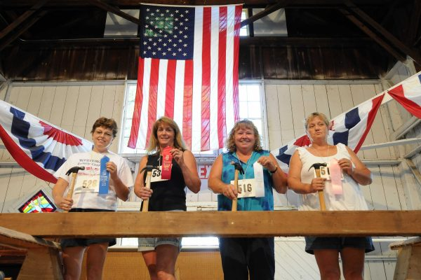 Winners show off their ribbons in the Ladies Nail Driving Contest at Farm Bureau Pioneer Hall.