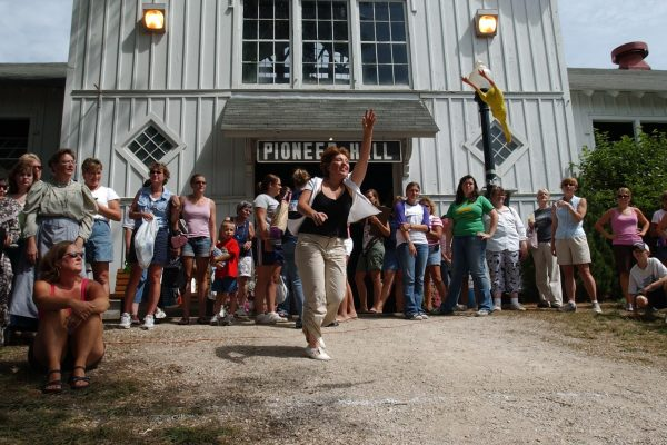 A participant in the Ladies Rubber Chicken Throwing Contest outside of Farm Bureau Pioneer Hall.