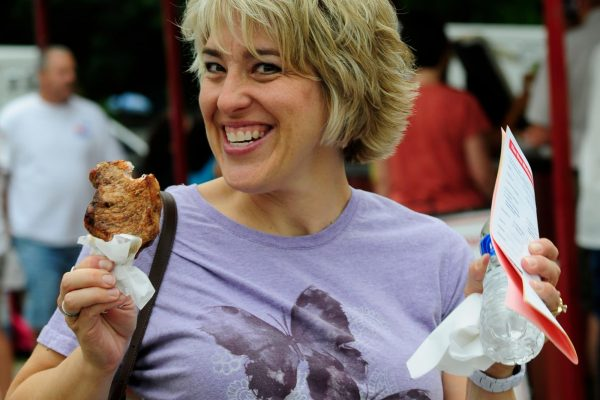 Julie Taylor of Earlham munches on a Pork Chop On-a-stick.