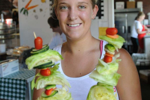 A Salad Bowl employee poses in the Agriculture Building with the popular Salad On-a-stick.