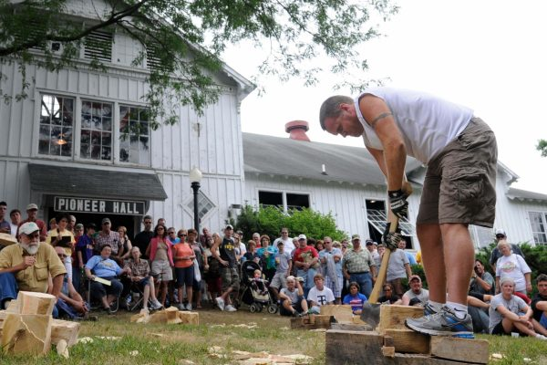 Chris Spencer of Moravia takes a swing at the Wood Chopping Contest.