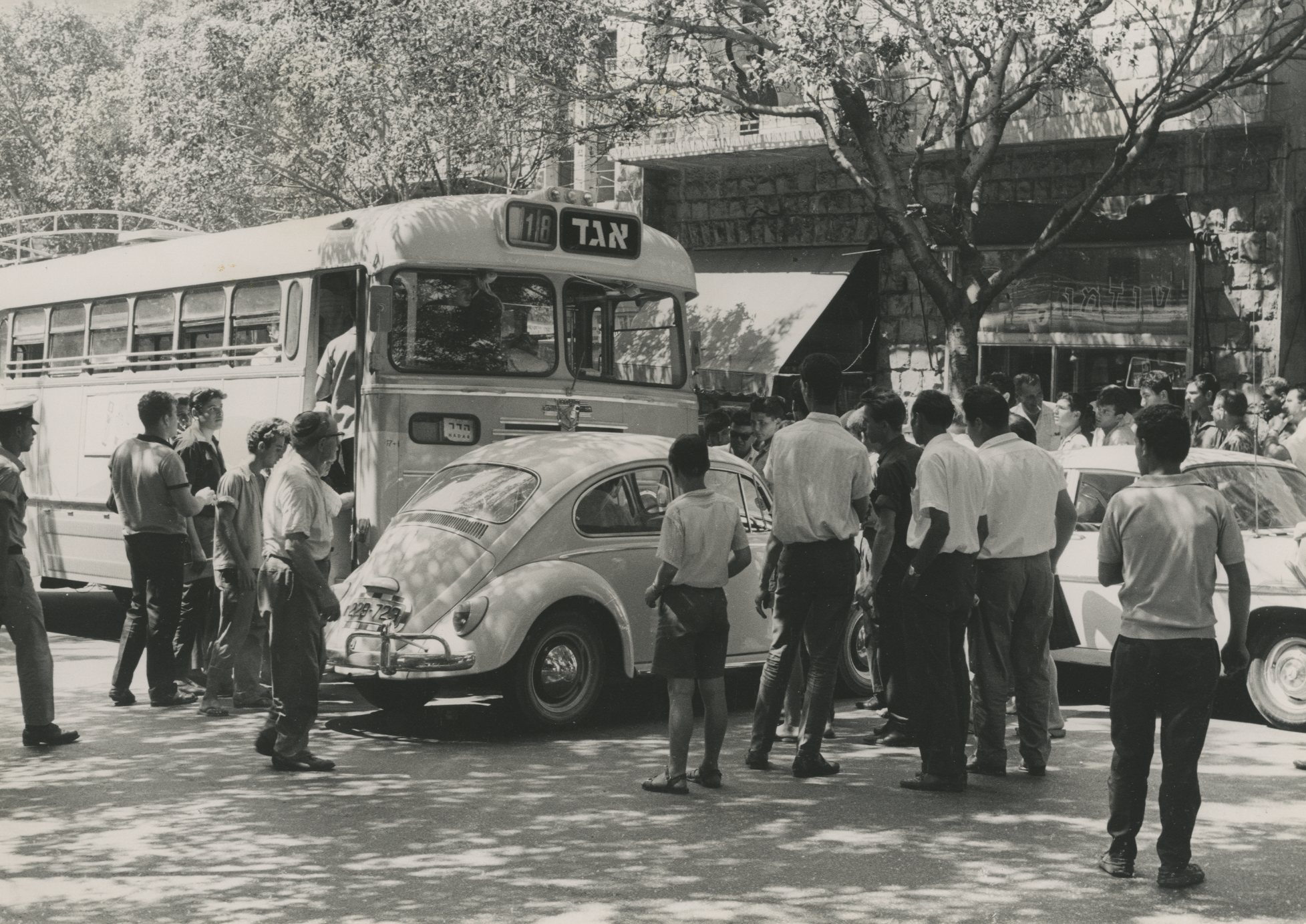 Car accident involving a bus and a Volkswagen on Herzl St , Haifa