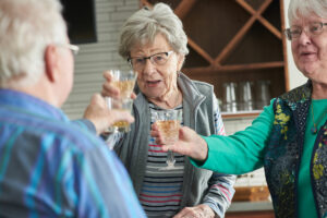 Seniors raising glasses and smiling