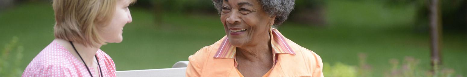 senior woman smiling outside