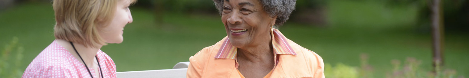 a senior woman smiling in a retirement community