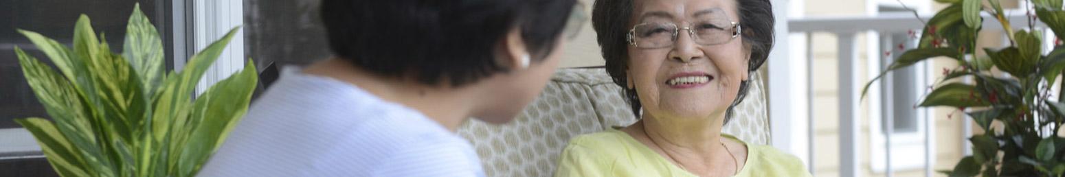 two seniors talking in their retirement community