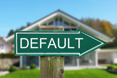 Information about consequences of default on second mortgage as a sign with default written on it pointing to another house