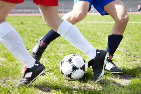 Soccer tackle | VantageScore vs. FICO