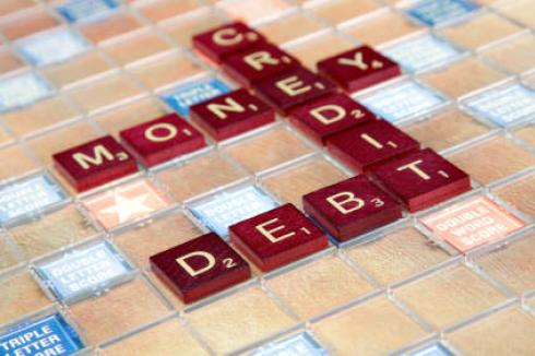 Credit Debt Money: Tiles on a Scrabble board