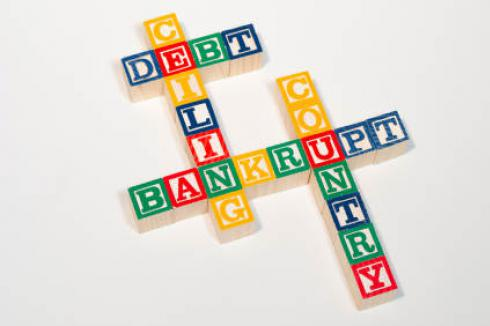Child building blocks spelling 'Debt Ceiling Bankrupt Country'