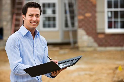 Man with checklist on home site | Appraisal and Home Inspection