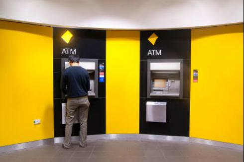 Man at ATM | Account Levy