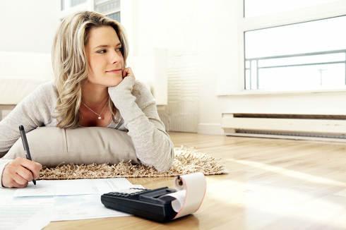 Woman doing paperwork | Pondering an ARM refinance