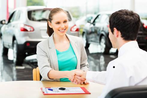 Woman signs automobile deal \\ Refinance Car Loan