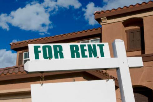 Refinance Rental: For Rent sign in front of house