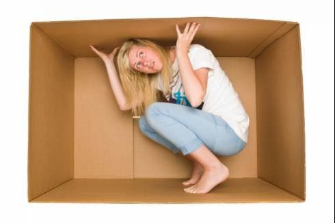Trapped by debt | Woman trapped in a box
