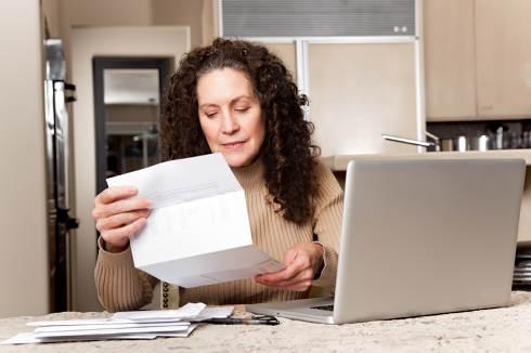 Woman Pays Bills | Utility debt collection