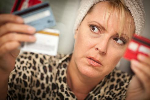 woman wondering if to consolidate her accounts with debt collectors?