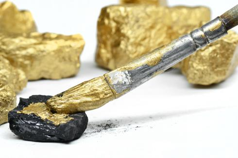 Warning signs of a financial scam shown as coal painted as gold