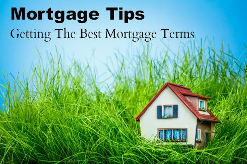 Mortgage Tips Getting The Best Mortgage Terms written on a blue sky with a mini house in grass