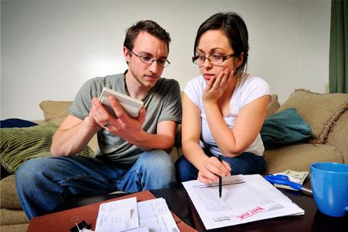 Couple in debt considering Credit Card Debt Settlement
