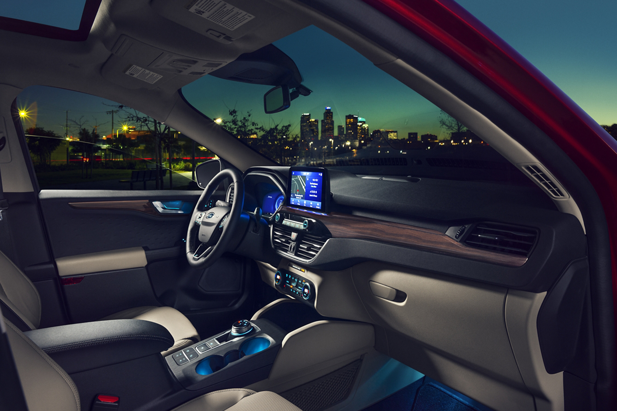 interior of a red 2020 ford escape at nighttime
