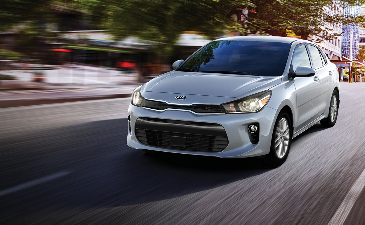 2018 Kia Rio driving City Street