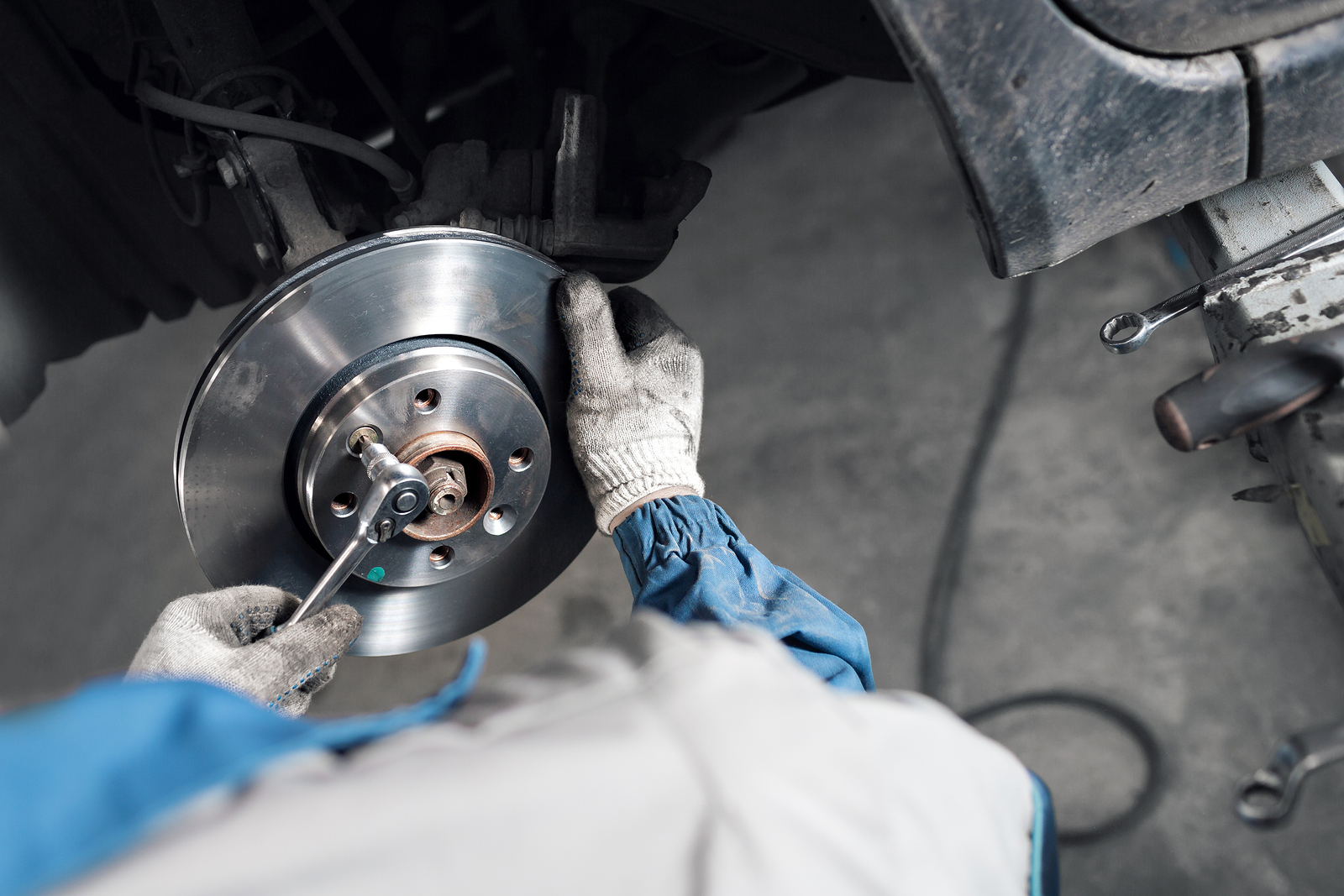 technician changing automotive brakes