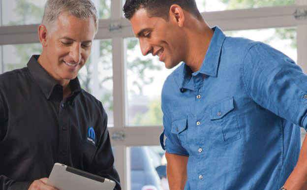 Customer Schedules Automotive Maintenance with Mopar Service Technician