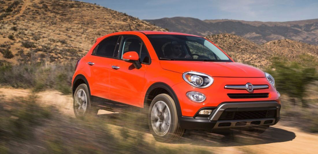 Oragnge Fiat 500x Trekking offroading on dirt road
