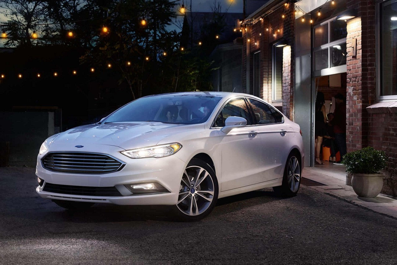 Ford Fusion in front of garage