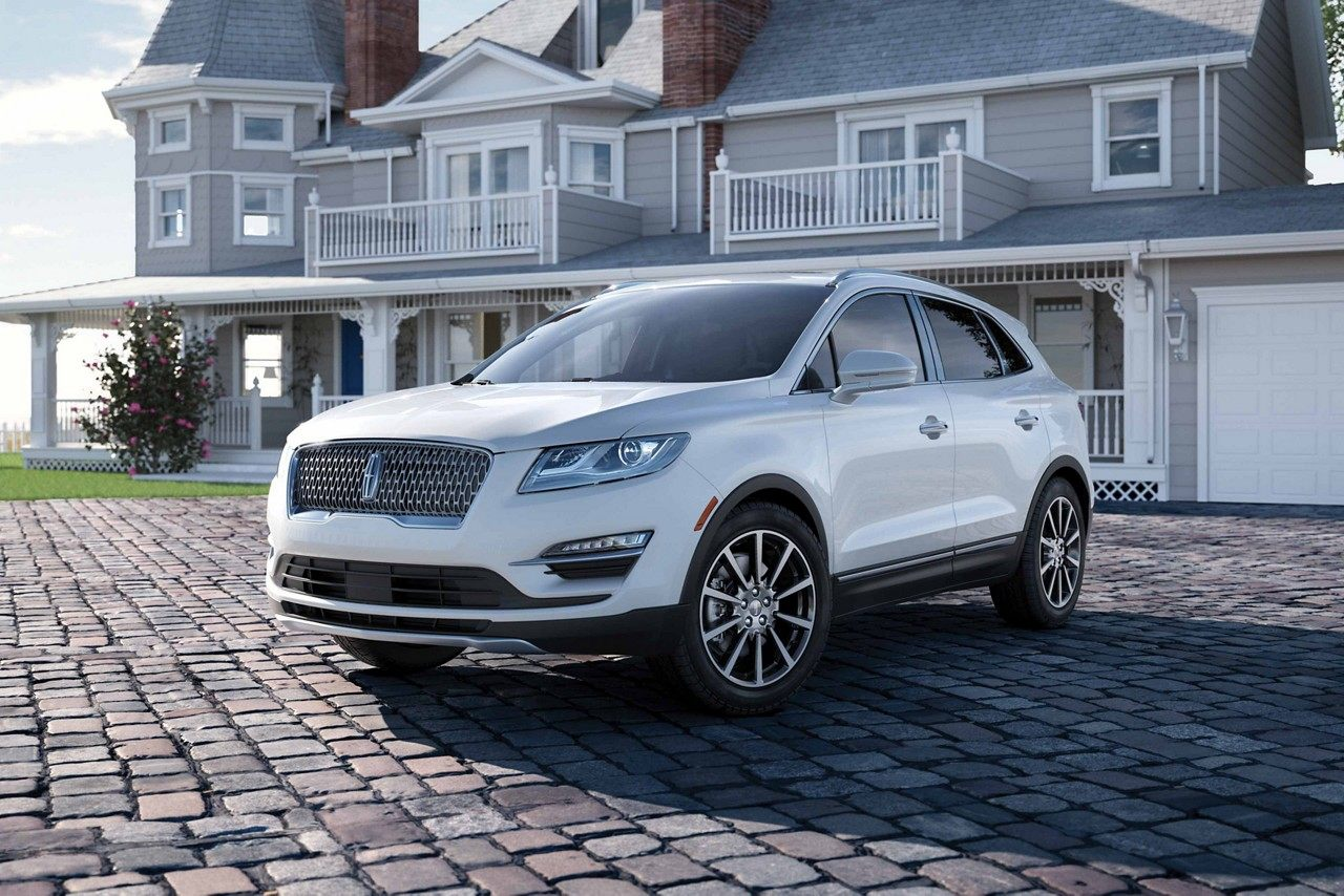 White 2019 lincoln MKC parked in driveway
