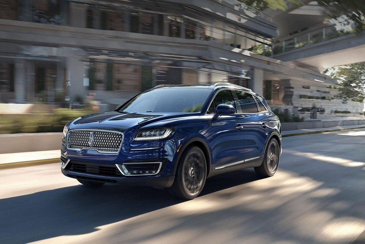 Blue 2019 lincoln nautilus driving down the road