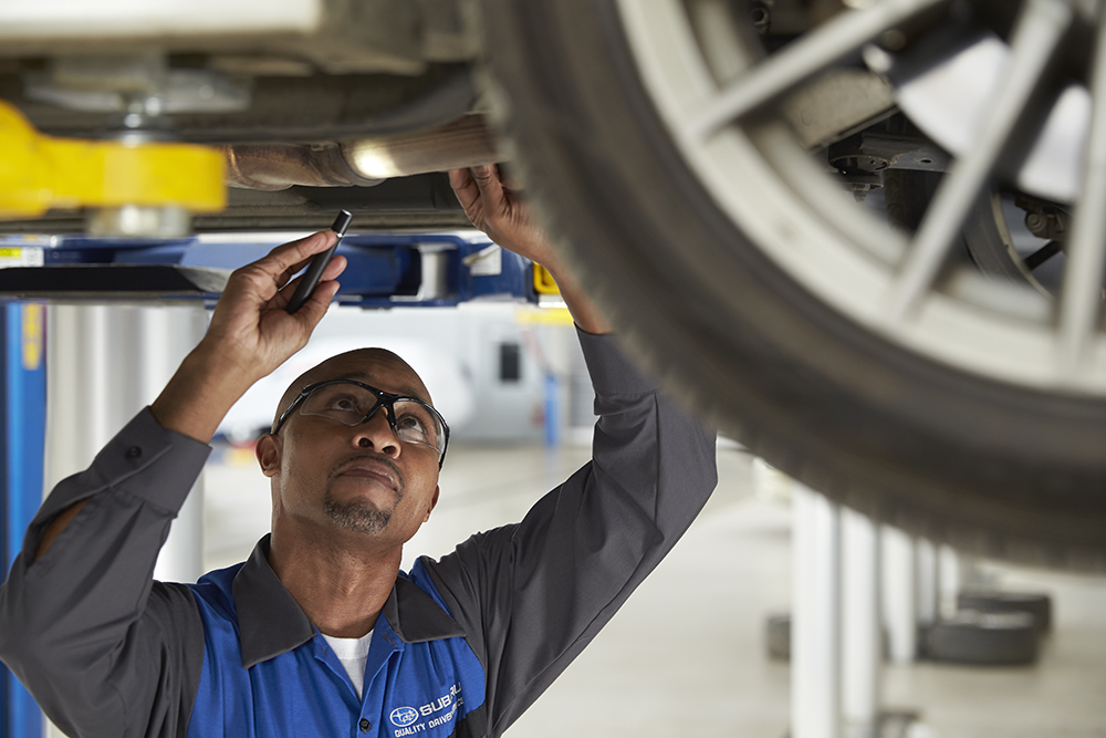 Subaru technician working on a vehicle