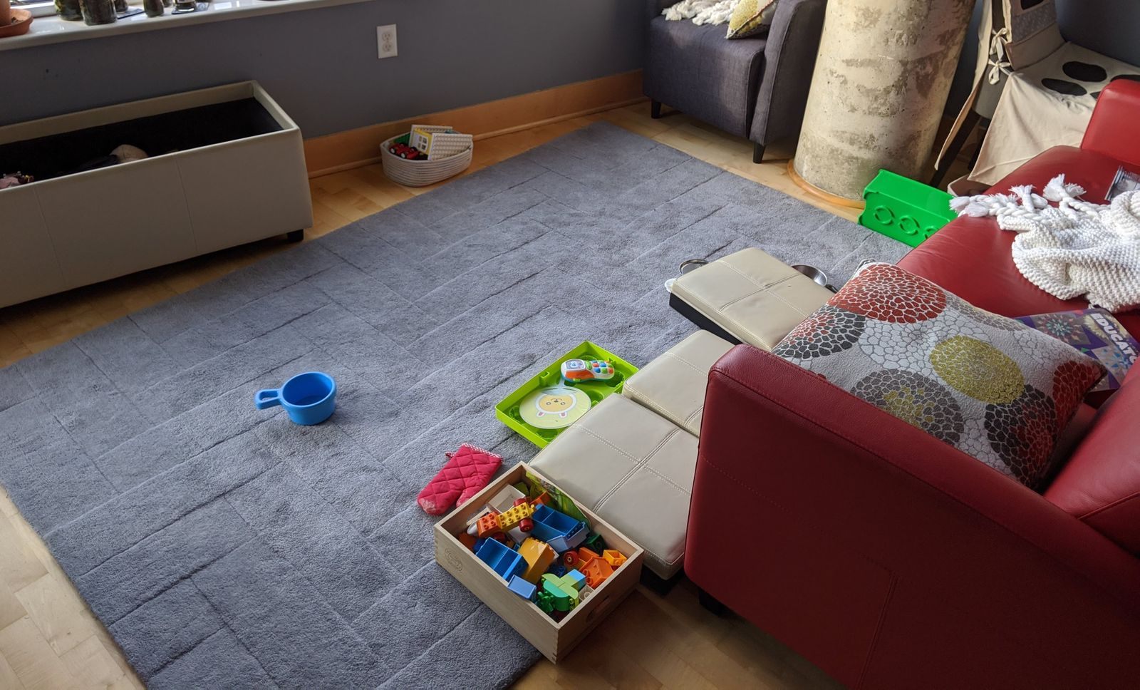 The toy chest doesn't just store toys - it is a toy! Shown here as a couch - complete with her phone right next to her.