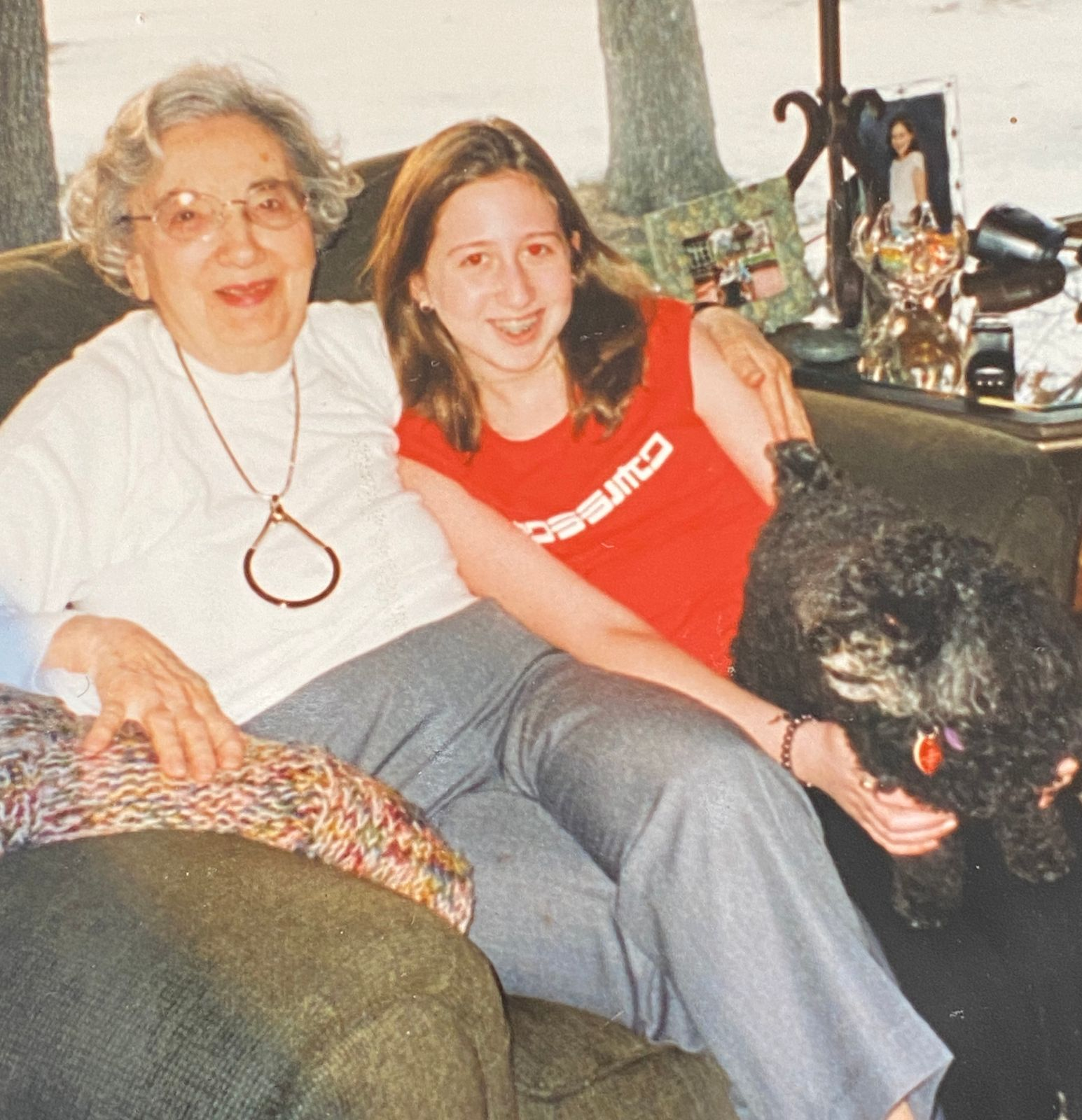 bby with her grandmother and her dog Bailey, 2001. A pet can take some of the focus off an only child.