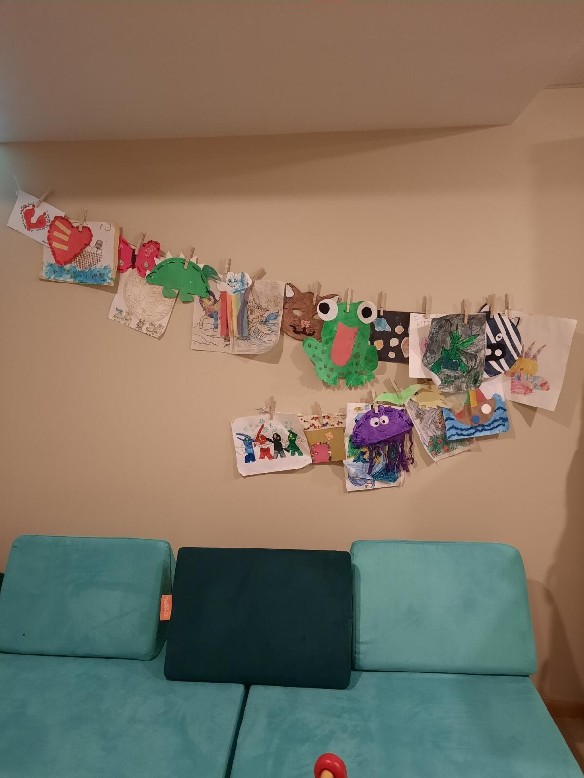 Emma hangs her kids' best art here.
