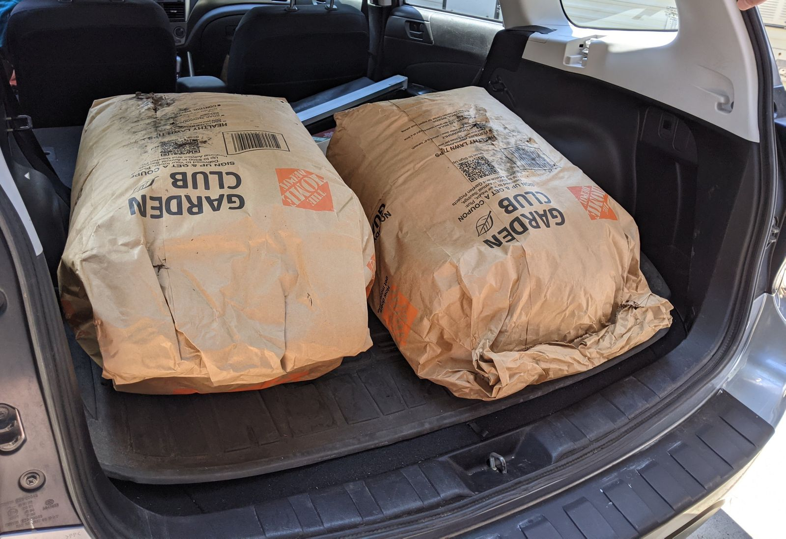 They could have fit all four bags in here to begin with, but they were cautious with their mulch consumption. I, of all people, cannot blame them.
