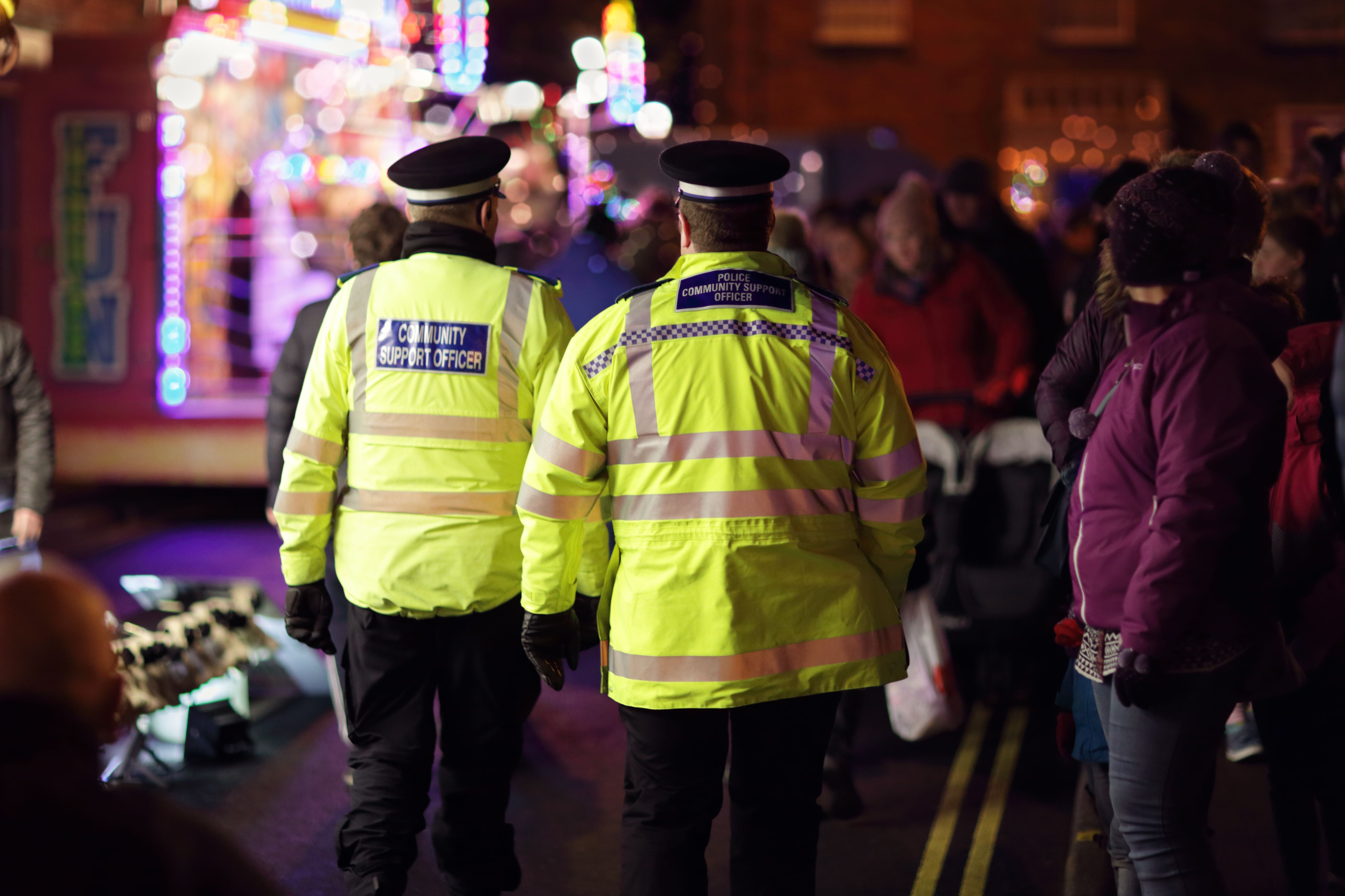 Police in hi-visibility jackets practising crowd control at an event in the UK