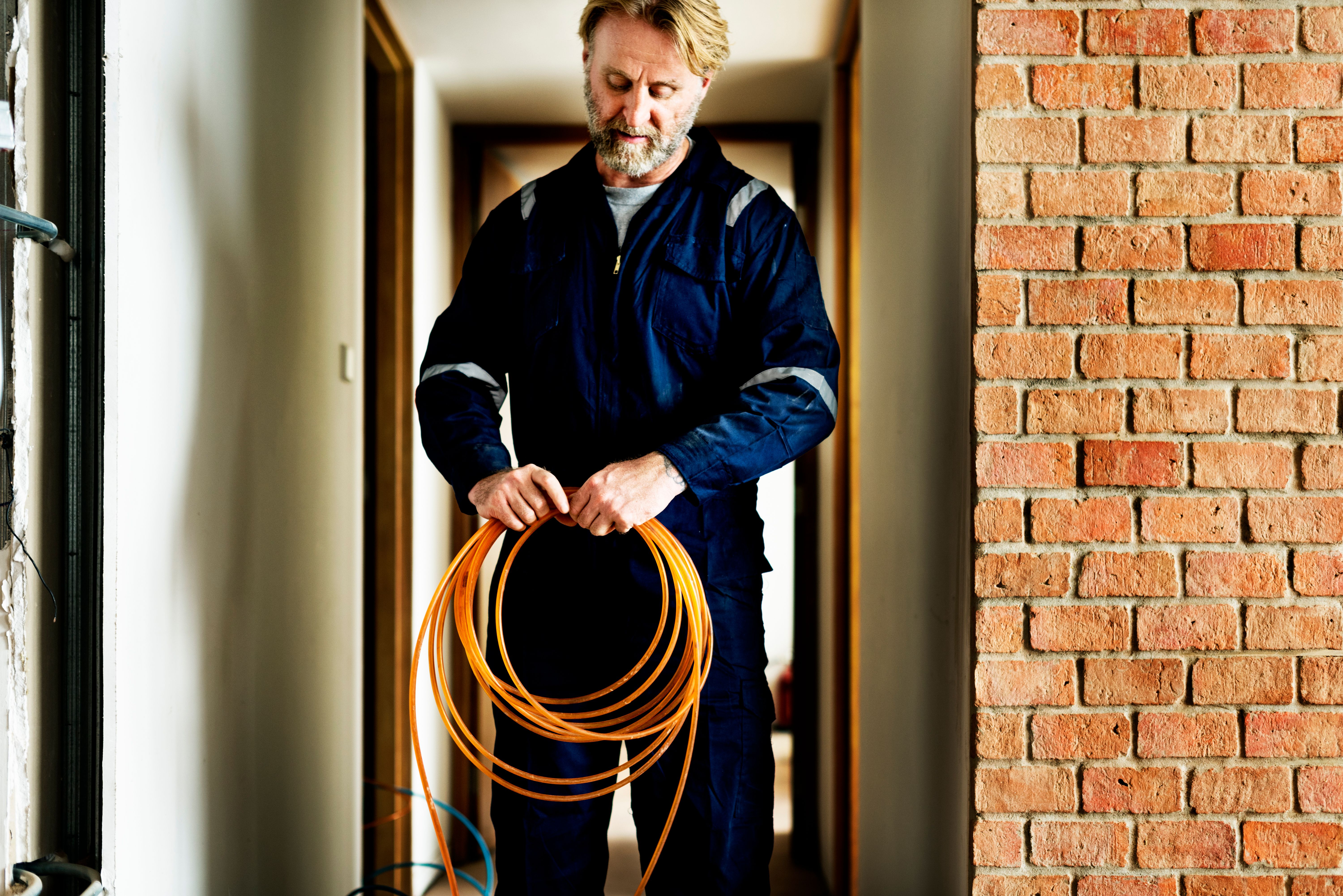 An electrician working on an installation at a house