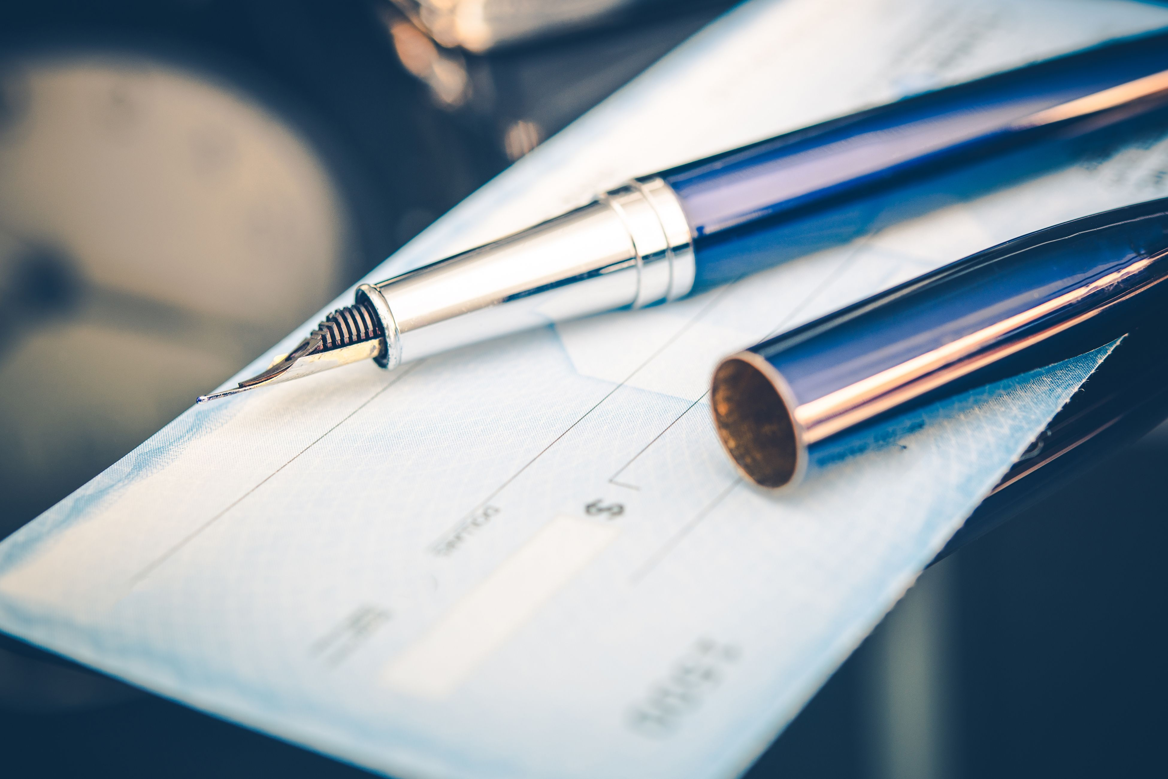 Issuing payment by check by using a fountain pen