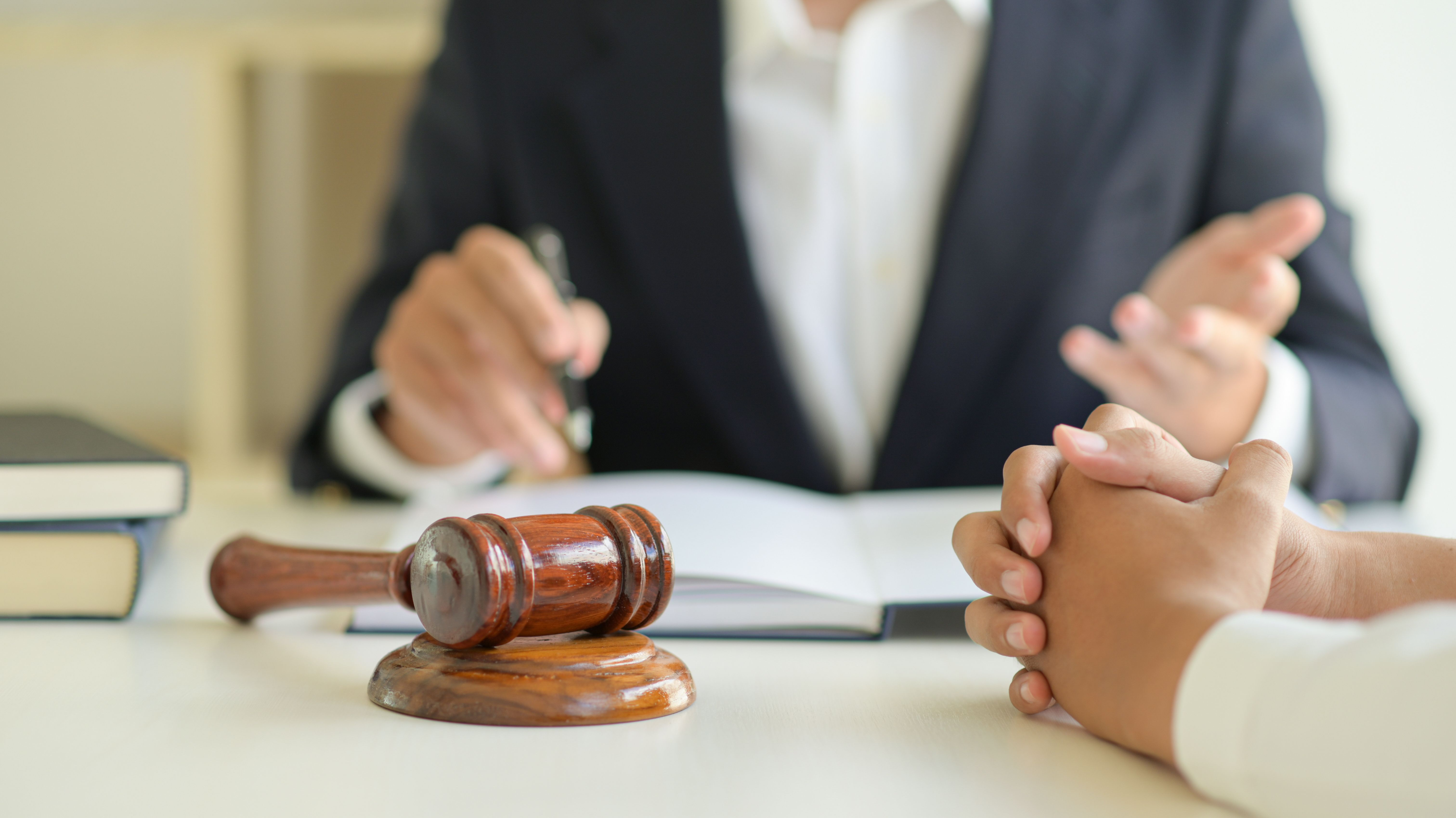 A lawyer is giving legal advice to a client