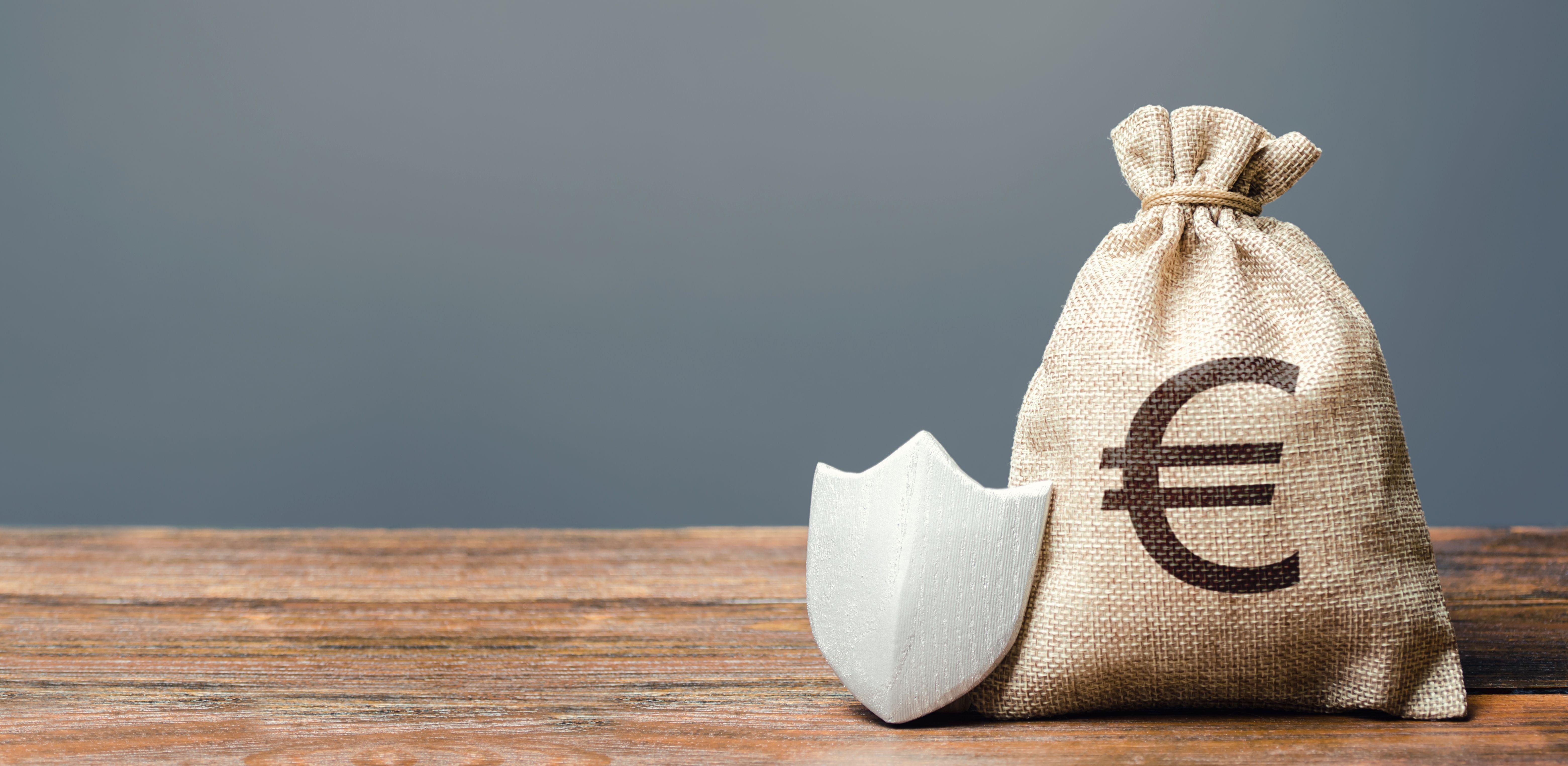 A guard beside a bag of money